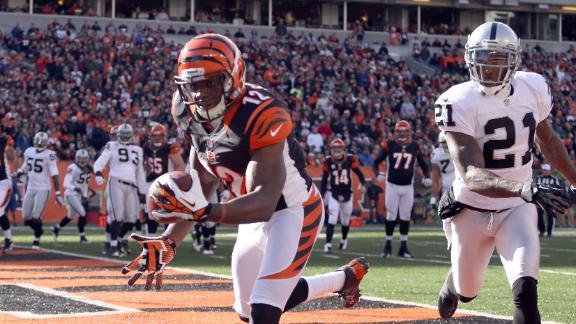 Dalton outduels Palmer, tosses 3 TDs in rout