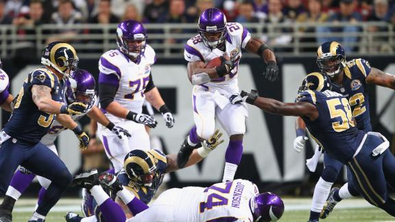 Peterson's 212 yards power Vikings to win