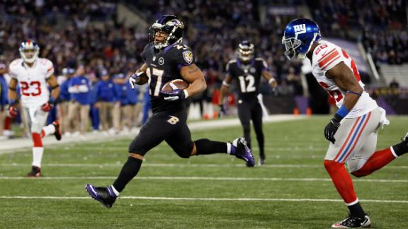 Flacco, Ravens roll Giants to win AFC North title