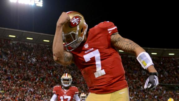 Niners ride Kaepernick's arm, legs past Pack