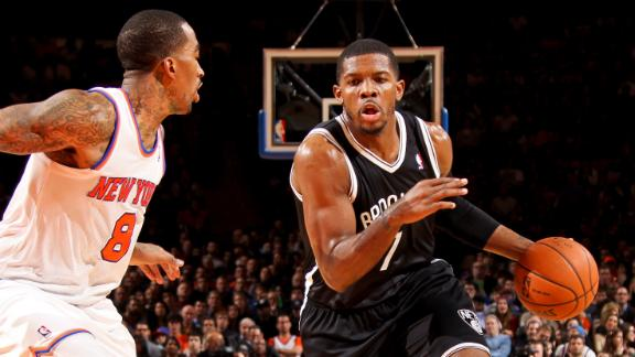 Johnson's jumper gives Nets split with Knicks