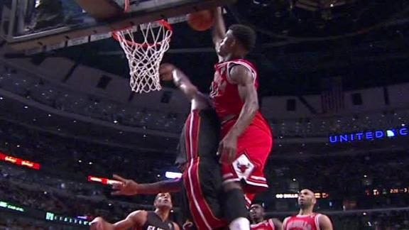 Video - Jimmy Butler Dunks Over Chris Bosh