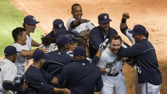 Brewers get past Rockies on walk-off sac fly