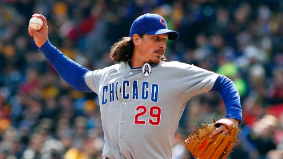 Samardzija stikes out nine as Cubs hold on