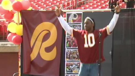 RG III does jumping jacks for team's fans