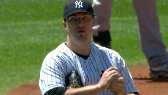 Hughes gets 1st win as Yanks double up A's