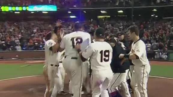 Giants win offensive tussle with another walk-off