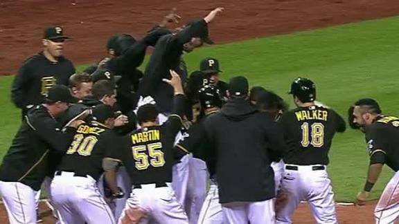 McCutchen hits walk-off homer as Bucs win in extras