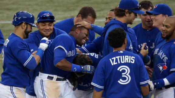 Davis' single lifts Jays past Rangers in 18th