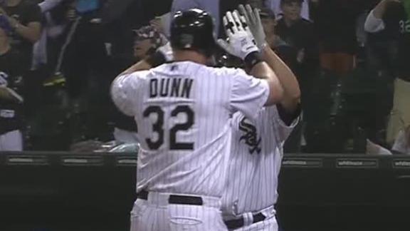 Dunn belts 2 HRs to power White Sox in fog
