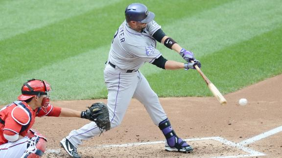 Cuddyer's hitting streak at 21 as Rockies win