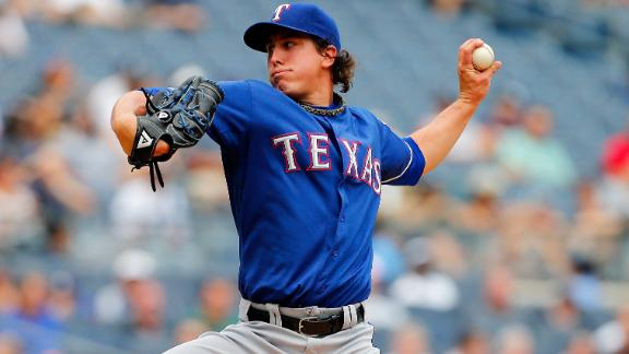 Holland's two-hitter helps Rangers tame Yanks