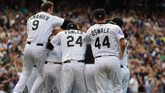 Cuddyer runs hit streak to 26 in Rockies' win