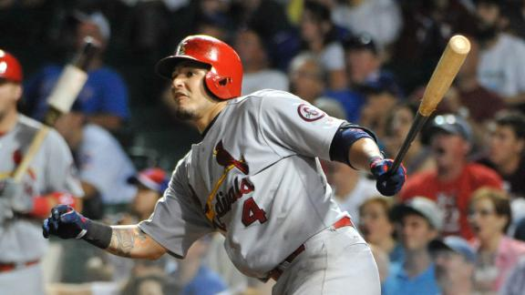 Cards register 4 in 9th to keep Cubs at bay