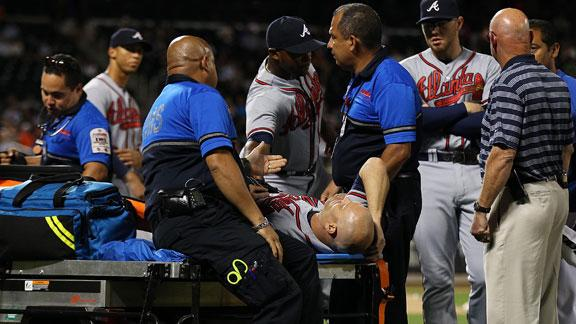 Braves' Hudson spiked in leg, carted off field