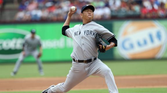 Kuroda blanks Rangers as Yanks split series