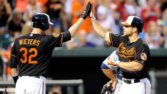 McLouth's slam gets Davis, O's past Mariners