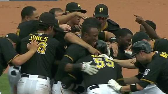 Martin's single in 10th keeps Pirates rolling