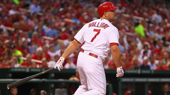 Holiday, Cards keep rolling by beating Reds