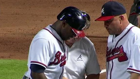 J. Upton leaves game after pitch hits hand