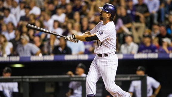Helton's six RBIs lift Rockies over Reds