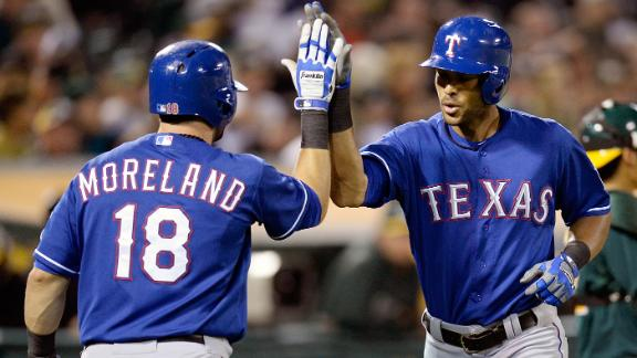 Perez, Rangers top A's to break tie for 1st