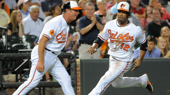 Tillman, O's top Yanks as managers quarrel