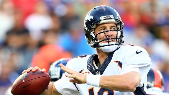 Peyton's Broncos get the best of Eli, Giants