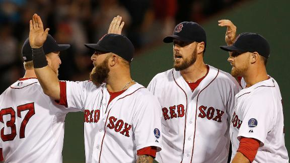 Red Sox clinch playoff spot on Lackey's gem