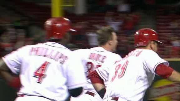 Reds best Mets in 10th to clinch playoff berth