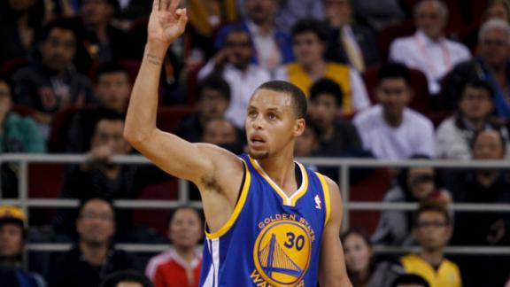 Lee sparks Warriors past Lakers in Beijing