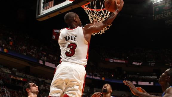 Heat hang on against Clippers behind Wade