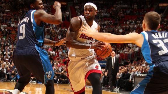 Heat outlast Mavs behind LeBron, Wade