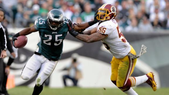 Eagles hold off Redskins to claim first place