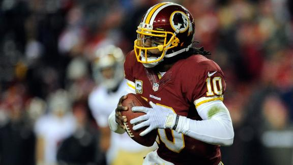 RG III defends dad being in locker room