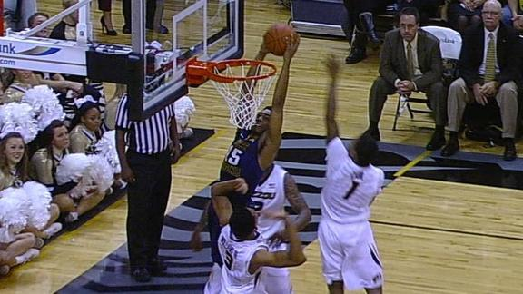Henderson Dunks Above Three Mizzou Defenders