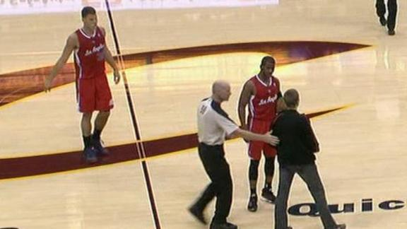 Cavs fan walks on court, displays Irving shirt