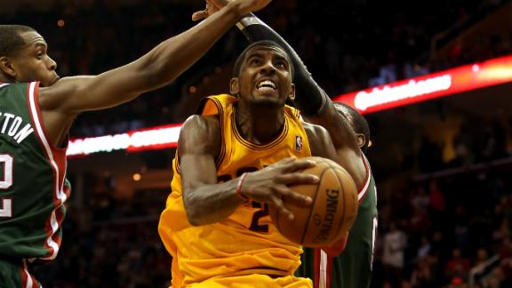 Irving scores 39 despite flu in Cavs' OT win