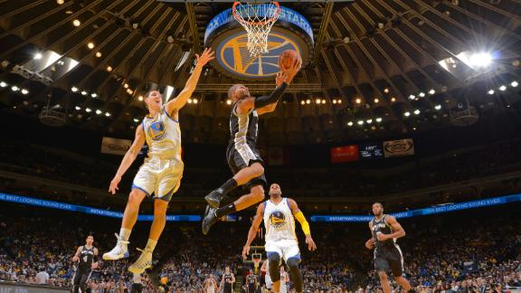 Short-handed Spurs slip past Curry, Warriors