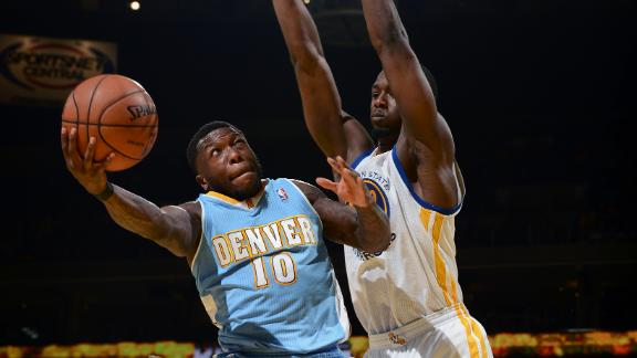 Robinson helps Nuggets outlast Warriors
