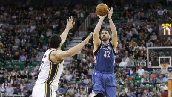 Love's 1st triple-double powers Wolves' win