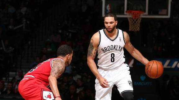 Collins makes home debut as Nets rout Bulls