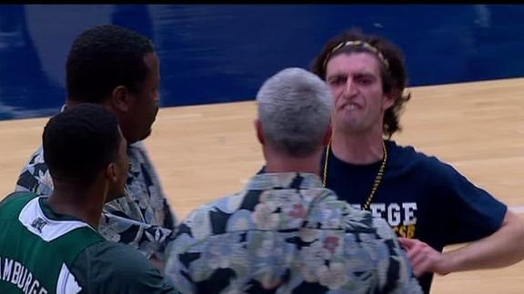 Fan Storms Court, Confronts Coach