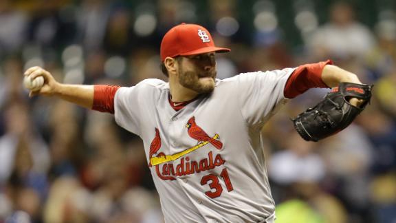 Cardinals snap Brewers' 9-game win streak