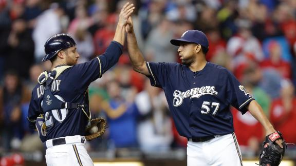 Peralta, Brewers avoid sweep against