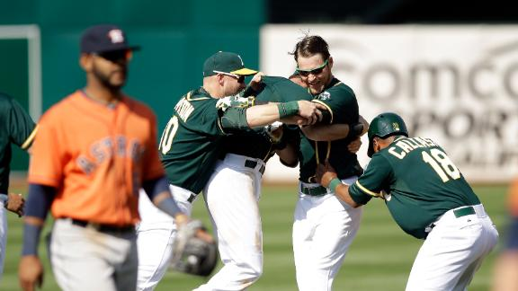 A's use 3-run burst in 9th to rally past Astros