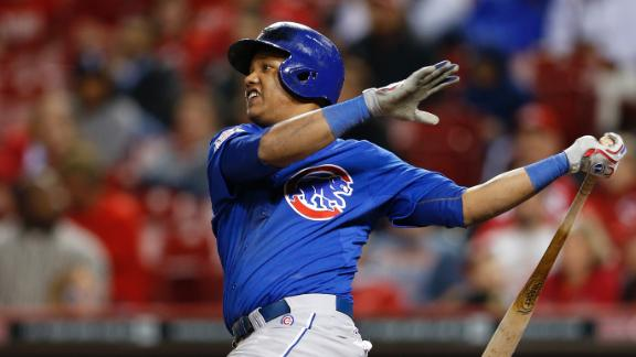 Cubs cap rally over Reds with four-run 9th