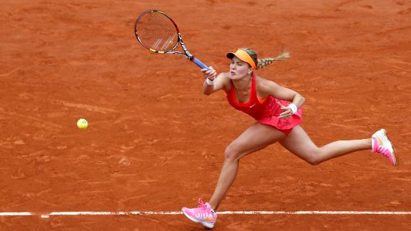 Bouchard Rallies To Beat Suarez Navarro
