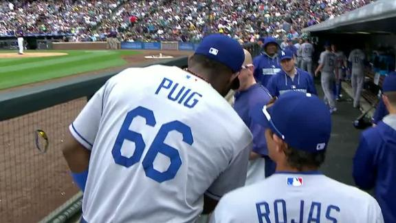 Puig exits early, day to day with hip strain