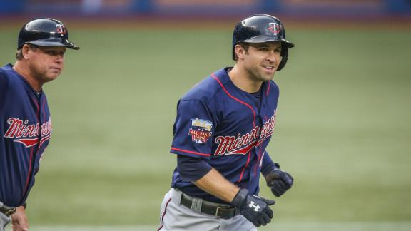 Twins' bats, Correia overpower Jays for win